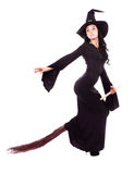 Witch flying on a broom. Pretty sexy young brunette witch flying on a broom, isolated against white background Stock Photography
