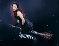 Witch flying on broom stock images