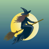 Witch. Flying on a broom against the backdrop of the moon Stock Image