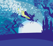 Witch flying on a broom in moonlight. Stock Photo