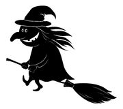 Witch flying on broom, silhouette Royalty Free Stock Photography