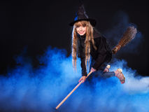 Witch flying on broomstick. Royalty Free Stock Images