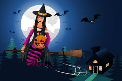 Witch Flying in Front of the Full Moon Royalty Free Stock Photography