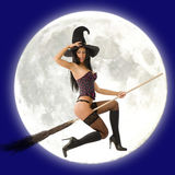 Witch flying in front of moon Royalty Free Stock Images