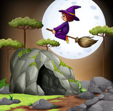 Witch flying over the cave Stock Image