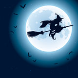 Witch flying over the moon Royalty Free Stock Photo