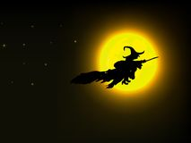 Witch flying over the moon Stock Image
