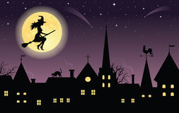 Witch flying over a town. stock illustration