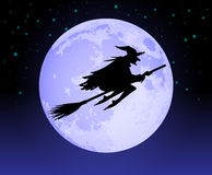 Witch Flying Past the Moon Stock Images