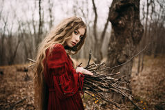 Witch in forest. Beautiful witch who lives in the woods Stock Image