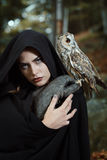 Witch of the forest with her owl friend Royalty Free Stock Photography