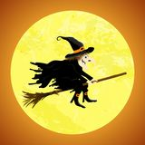 Halloween witch in front of full moon Royalty Free Stock Image