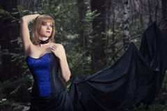 Witch girl in forest Royalty Free Stock Images