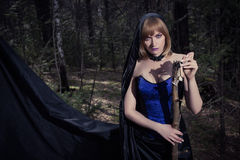 Witch girl in forest Stock Photography