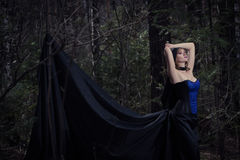 Witch girl in forest Royalty Free Stock Photo
