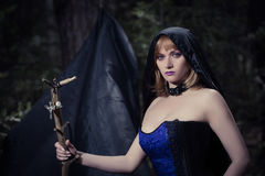 Witch girl in forest Stock Photo