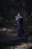 Witch girl in forest Stock Image