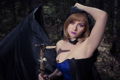 Witch girl in forest Royalty Free Stock Photography