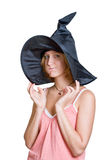 Witch girl in a halloween black hat Stock Images
