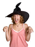 Witch girl in a haloween black hat. Girl in a haloween black hat Stock Photography
