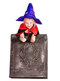 Witch  girl holding  book. Royalty Free Stock Photography