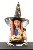 Witch girl looking surprised in pumpkin Stock Images