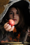 Witch giving a poisened apple Stock Photo