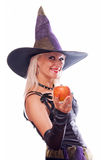 Witch giving poisonous apple Royalty Free Stock Images