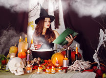 Witch with a glass of blood Stock Photography