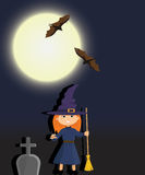 Witch in a graveyard night royalty free stock images