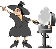Witch grilling burgers Stock Image