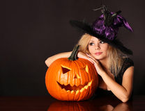 Witch with Halloween pumpkin royalty free stock images