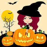 Witch of Halloween in pumpkin graveyard background Royalty Free Stock Photography