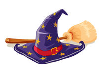 Witch hat and broomstick Royalty Free Stock Images