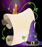 Witch hat and burning candles. Witch hat with parchment and burning candles on a dark background Royalty Free Stock Photo