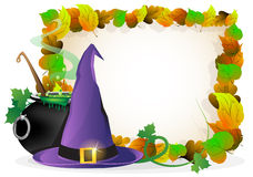 Witch hat and  cauldron on autumn leaves backgroun Stock Photos