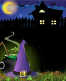Witch hat, cauldron and haunted house Royalty Free Stock Photos