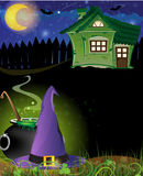 Witch hat, cauldron and haunted house Stock Image
