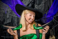 Witch in a hat with green halloween shoes Royalty Free Stock Photo