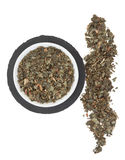 Witch Hazel Herb. In a porcelain bowl and loose over slate round and white background stock images