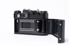 Old Soviet Zenit TTL 35 mm film camera isolated on white. Witch Helios 44-2 lens Royalty Free Stock Images