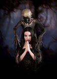 Witch and her familiar royalty free stock photo
