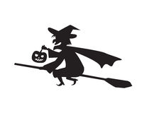 Witch hold pumpkin lamp on a broomstick Stock Photos