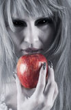 Witch holding an apple Royalty Free Stock Photos