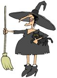 Witch holding a cat and broom Stock Images