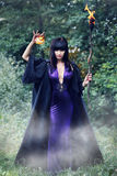 Witch holding a fireball Stock Photo