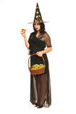 Witch holding fruits Stock Image