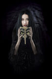 Witch holding a mask royalty free stock photography