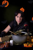 Witch holding poisoned apple at Halloween Stock Photography