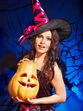 Witch holding pumkin. Happy witch holding pumkin Royalty Free Stock Images